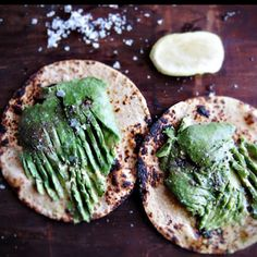 Avocado and a squeeze of lemon on handmade toasted tortillas.