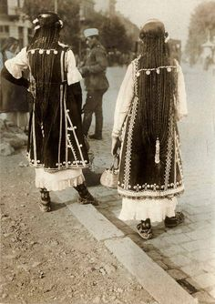 Here are two Bulgarian girls from the Shoppe (Sofia) region in 1915, wearing an amazing traditional hairstyle. It consisted of 30 or more long braids fastened with gold and silver coins.