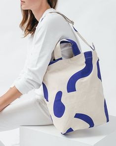 A perfect everyday tote from Baggu in durable recycled cotton canvas duck.  Two handles and 40 inch adjustable strap f17fa2900c7b