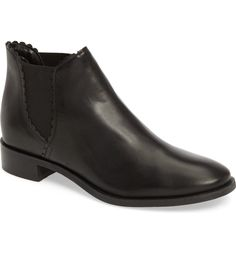Scalloped trim adds a pretty touch to this sleek Chelsea boot in smooth leather.
