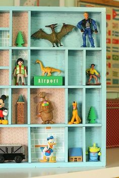 i keep searching for an old box like this for my boys to display their Lego people, but I love the idea of adding the paint color and scrapbook paper in a few of the boxes