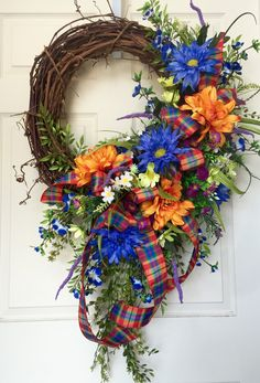 Everyday or Summer Blue, Orange, Purple Round Grapevine Wreath by WilliamsFloral on Etsy https://www.etsy.com/listing/234916606/everyday-or-summer-blue-orange-purple