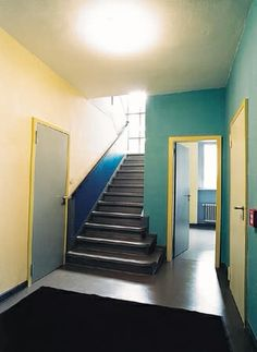 Black and white photography of early modernist spaces can be misread as having been painted gray and white. Here in the Bauhaus Dessau Masters' House of Paul Klee soft yellow, gray, Prussian blue, and a green-blue.