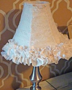 Give old lamps a face-lift in less than an hour by using scrap fabric, lace, and ribbon. This ruffly version is perfect for a room that needs a feminine touch or even for a nursery.