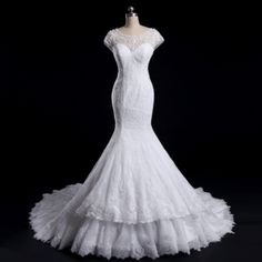 This cap sleeve wedding gown has an illusion neckline.  The fit-and-flare style cut adds to the fashion design. The extra added touch of a tiered skirt near the hem gives the design personality. Have this Darius Cordell wedding gown recreated with any design change you need. We also provide #replicas of couture wedding dresses for brides on a budget. Just email us for pricing and more information about our process.