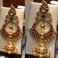 Vary large and huge chandbalis hanging with kundan jhumka in 22 carat gold style. Paisley patterned design comes in the top part of the e. Pakistani Jewelry, Indian Wedding Jewelry, Indian Jewelry, Bridal Jewelry, Gold Jewelry, Ruby Jewelry, Trendy Jewelry, Gold Jhumka Earrings, Gold Earrings Designs