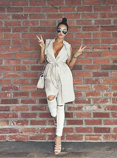 Creme colored trench jacket and white ripped jeans