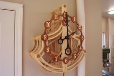 """This is a highly modified version of Clayton Boyer's """"Leeds"""" clock. The light colored wood is maple, the darker wood used in the dial is called goncalo alves."""