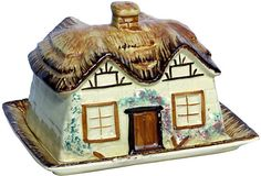 "This charming Cottage Ware covered butter dish has raised decoration. The lid is a thatched roof with a chimney finial. Marked ""KSP,"" which stands for Kelle St Pottery Co. of England."