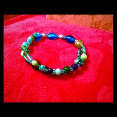 Flex wrap bracelet. Sea toned beads. Flexible wrap bracelet in sea tones fits most wrist sizes. Handmade by Kiwi Kissed Designs. Jewelry Bracelets