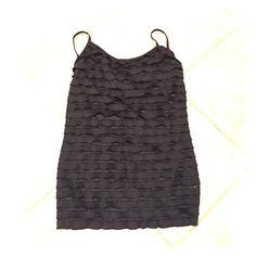 Black Ruffle Tank Top Black ruffle tank top! Great Condition, never worn. Bundle with skirt as shown and get 10% off your order! Energie Tops Tank Tops
