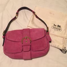 EUC Authentic Coach pink suede Soho bag  Offers accepted! EUC Pink Suede and leather Coach Dual Pocket Soho Shoulder Handbag.  Clean inside and out, except for small pen mark seen in pic #4. Leather strap with whipstich.  Flap with faux buckle has magnetic clasp.  Dust bag included. This bag is beautiful and so soft!! Coach Bags Shoulder Bags
