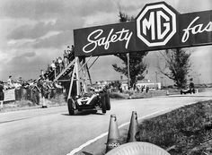1959 US GP - Jack Brabham in his Cooper Climax T51    Jack Brabham (later Sir Jack) lifts a wheel on his Cooper Climax T51 as it passes under the MG Bridge at the 1959 US Grand Prix held at Sebring, Florida. Jack ran out of gas on the last lap of the race and pushed his car the rest of the way to finish fourth. By doing so he earned enough points to win the driver's championship in 1959 beating out Stirling Moss.
