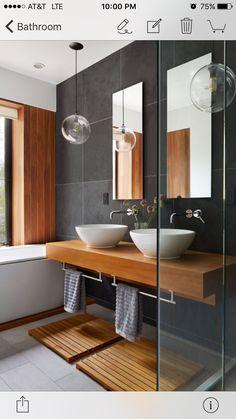 Love the combo of wood & slate - plus the towel rails under the shelf
