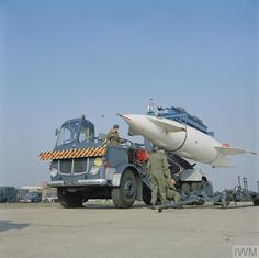 A Blue Steel stand-off missile being lowered from a transporter on to a trolley prior to be loaded on an awaiting Handley Page Victor aircraft [unseen], probably of No 100 Squadron at RAF Wittering, Northamptonshire. Note: This is a nuclear missile. Aircraft Photos, Ww2 Aircraft, Military Aircraft, Handley Page Victor, V Force, War Jet, Avro Vulcan, Post War Era, Old Lorries