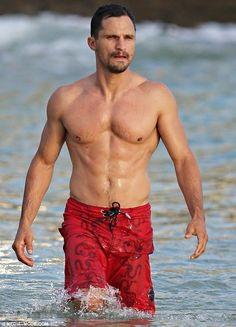 Bad boy body: Actor Dan Mor showed off his toned physique wearing just a pair of red board...