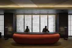 HOSHINOYA Tokyo: The reception on the second floor plays on a trompe l'œil effect. Its counter appears to magically float above the console it rests upon.