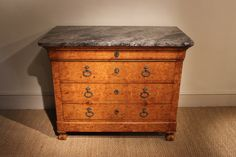 A good quality and with a lovely colour, 19th century French, Louis Philippe marble top commode in burr elm, retaining its original hardware and marble.