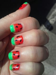 """Watermelon nails. Painted 2 coats Kleancolor neon fuchsia and then pink glitter on bottom half of nail Stamped on the heart """"seeds"""" using a bundle monster plate a konad black polish.  Sponged on wet n wild white on the tips let dry and followed with sponged on Kleancolor neon green."""