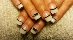 White acrylic nail tips with black 3D bows and nail art