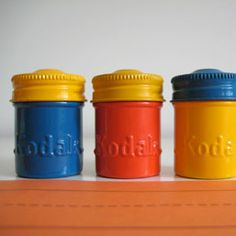 these vintage Kodak film canisters are so cute! i love the colors.