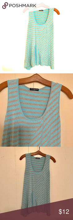 """Easygoing striped slub tank Heathered grey and light blue striped slub tank. Flattering and lays very nicely at bust and top, yet relaxed and flowy on mid-torso and bottom. The sides are longer to assist in flow and movement. Excellent condition. 96% rayon, 4% spandex. Approximate measurements are shoulders; 12"""", bust: 33"""", waist: 40.5"""", hips: 51"""", length from shoulder to hem: 27"""". Cha Cha Vente Tops Tank Tops"""
