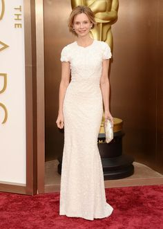Modest white short sleeve embroidered dress. Arrivals at the 86th Annual Academy Awards — Part 14 In This Photo: Calista Flockhart Actress Calista Flockhart attends the Oscars held at H...