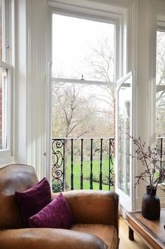 Comfy setting, clean atmosphere, and wrought-iron railing. Beautiful Space, Beautiful Homes, Interior And Exterior, Interior Design, Exterior Colors, Distressed Decor, Iron Balcony, Leather Club Chairs, Wrought Iron Gates