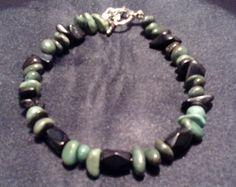 Black and Green Stone with Black Jasper by BeadedAssortment Leopard Spots, Palmistry, Green Stone, Craft Items, Wooden Beads, Painted Rocks, Jasper, Tarot, Glass Beads