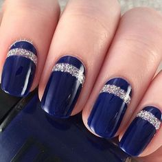 Get classic with this midnight blue nail art design. On top are thick linings of silver glitter nail that compliments beautifully with the midnight blue background. Nail Design, Nail Art, Nail Salon, Irvine, Newport Beach