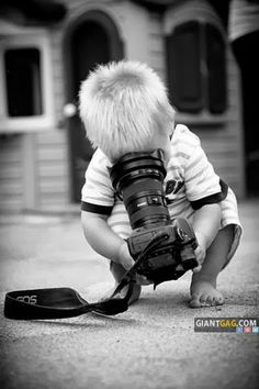 Young boy looking into a lense