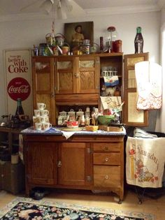 """Vintage 48"""" Sellers kitchen cabinet, with slag glass door inserts, flour and meal bin, cardboard shopping list door inserts, and much more."""