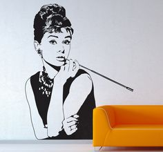 A great film wall sticker illustrating the one and only, Audrey Hepbur, the celeb movie actress who played Holly Golightly in Breakfast at Tiffany's. Superb silhouette decal to decorate your living room. A high quality decal that will help you maintain that elegant appearance at home. Super easy to apply and available in various colours.  #AudreyHepburn #stickers #decoration