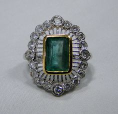 Emerald Ring , vintage 18K solid white and yellow gold hallmarked , Natural emerald Diamond gemstone ring. Beautiful collection piece in very good condition. Usa ring size -7.5 ( we can adjust size), 18 K gold weight-5.730 grams, size of top-28/18 mm, emerald weight-3.5 carat, diamond weight- 0.74 carat VS G. Will supply with certificate.
