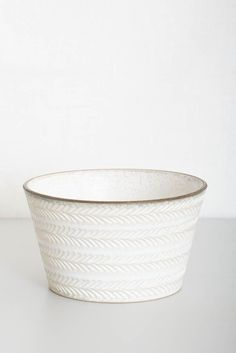 Hand-thrown Kyoto porcelain bowl by Japanese ceramicist Sachie Hashimoto. White etched pattern on outside with dark rim. A beautiful addition to the modern kitchen. Use as a breakfast bowl, salad bowl