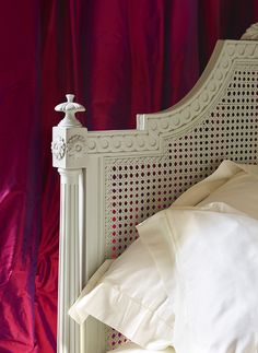 Hand-crafted detail on the Juliet Caned Bed from And So To Bed, hand painted in pale grey 'Perse' http://www.andsotobed.co.uk/juliet-caned-bed.html