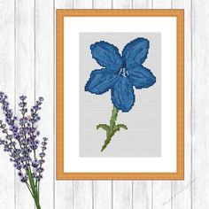 Medieval Blue Flower Cross Stitch Pattern by Joanna Marshall Purple Flower Cross Stitch Pattern - Digital Download.YOU WILL NEED14 Count Aida - White or PinkDMC Thread - 13 ColoursINSTRUCTIONSFull Cross Stitch Used Only65sts x 104sts11.79cm x 18.87cm  4.64in x 7.43inDIGITAL DOWNLOAD WILL INCLUDE1 x PDF - Colour Blocks - 6 Pages including instructions & image 1 x PDF - Colour Blocks with Symbols