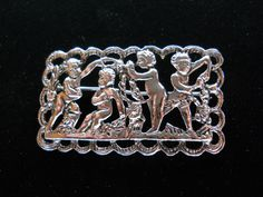 Coro Cherub Brooch Pin Silver Tone Vintage Signed by JanesVintageJewels on Etsy https://www.etsy.com/listing/208387420/coro-cherub-brooch-pin-silver-tone
