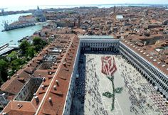 "Over one thousand residents of Venice participate in composing this living rosebud in St. Mark square in Venice, on occasion of the ""Festa del Bocolo"", a tradition dating back to the Middle Age, Frida"