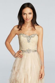 With it's elegant crystal and ruffle details, you'll surely be the trendiest Prom Queen of them all!  Strapless sweetheart bodice fashioned from a beautiful lace is embellished with high-shining crystal rhinestones.  Tiered ruffle