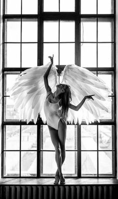 A fashion black and white wall art with the breath of the sun penetrating through big frosted window, back-liting an angel-like bellerina dancing with white feather wings and white leotards. Angels Among Us, Angels And Demons, Fantasy Kunst, Fantasy Art, Ange Demon, Angel And Devil, Foto Art, Victoria Secret Angels, Angel Art