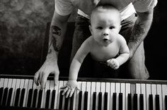 Father and son playing piano