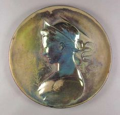 DELPHIN MASSIER POTTERY CHARGER decorated with Art Nouveau maiden bust in iridescent glazes, painted signature Delphin Massier Vallauris (A.M)