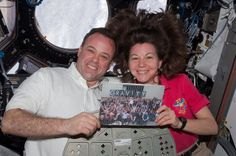 Yes there is #Gravity in space! NASA astronauts Ron Garan and Cady Coleman in the International Space Station cupola with a picture of the Gravity crew after filming was complete on the Oscar nominated film.