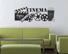 Enjoy the SHOW, CINEMA WALL DECAL This vinyl Cinema Wall Decal, with Movie Reel and Movie Popcorn will look great in you own Home Theater.   57 Wide x 22 Tall Please note: the actual size of the item in the picture may not be to scale.  (Shown in Black Vinyl) Please select the color of your choice from our color chart.  Custom sizes are available, please contact us if you need a different size. We can also do custom orders if you would like something changed. All of our decals can be…