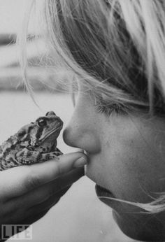 A young girl faces off with her pet frog in 1962 – Kids and Their Pets