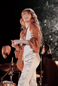 """I think I should get a bigger between-the-song persona, so that I'm not wandering around the stage like some mad old auntie that's saying hello to people and falling over.""  -Florence Welch"