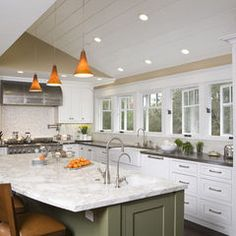 Windows, white cabinets, painted island, mix of marble/granite/mosaic