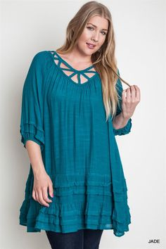 We love this tunic! It's so unique with so many visual details... geometric line on the neck and ruffles on the hem. It's a lightweight and flows nicely on the body. The jade green is also so peaceful