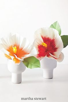 "Florist Cetti's paper version of this flower packs a tropical punch in just one bud. ""I came up with the idea to dip red and orange crepe paper in bleach to erase some of the color, and kept experimenting with it in my basement,"" she says.  #weddingideas #wedding #marthstewartwedding #weddingplanning #weddingchecklist How To Make Paper Flowers, Flowers For You, Real Flowers, Floral Centerpieces, Wedding Centerpieces, Paper Flower Garlands, Green Vase, Delphinium, Crepe Paper"
